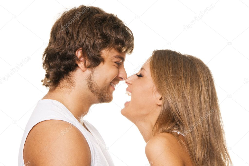 Young cheerful couple touched one another's nose  Stock Photo #5758240