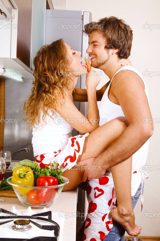 Young beautiful couple having fun in the kitchen — Stock Photo #5758479