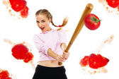 Lady beating off tomatoes with a baseball bat — Stock Photo