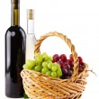 Bottles of red and white wine with grapes — Stock Photo