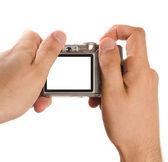 Kompakte digitalkamera in händen gehalten — Stockfoto