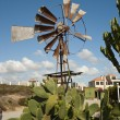Windmill with blue skies overhead — Stock Photo #6509739