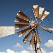 Windmill with blue skies overhead — Stock Photo #6509764