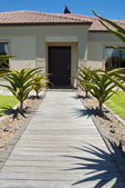 Walkway and front door of a house — Stock Photo
