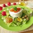 Goat cream cheese on salad — Stock Photo