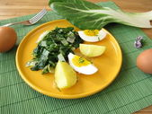 Eggs with chard vegetables and potatoes — Stock Photo