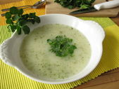 Cream soup with watercress — Stock Photo