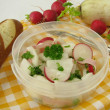 Stock Photo: Picnic with radish salad and lye roll