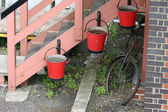 Fire buckets and bicycle. — Stock Photo