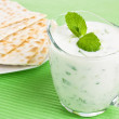 Tzatziki dip and matzo bread — Stock Photo