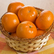 Stock Photo: Fresh tangerine in wicker basket