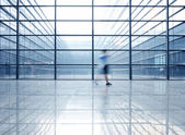 Silhouette in hall of office building — Stockfoto