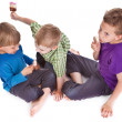 Three kids eating ice lolly — Stock Photo