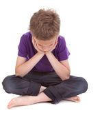 Sad boy with drooping head — Stock Photo