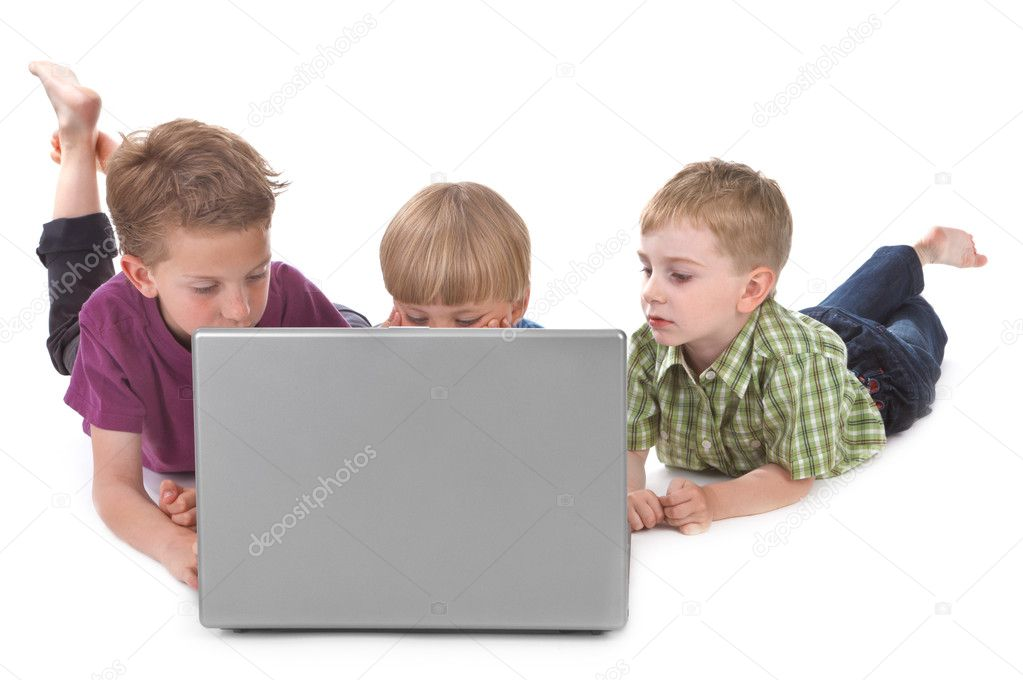 Studio shot of three kids with laptop  Stock Photo #6070252