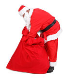 Santa Claus is looking for gifts — Stok fotoğraf