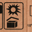 Stock Photo: Symbols on cardboard