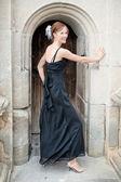 Portrait of a beautiful woman in black dress — Stock Photo
