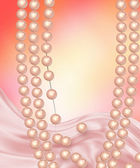 Pearl necklace with pink silk — Stock Photo