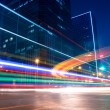 Light trails with blurred colors on the street - Stock Photo