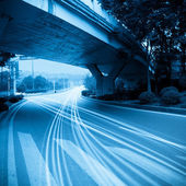 The traffic under the viaduct — Stock Photo