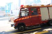 Fire truck rushing ,panning image — Stockfoto