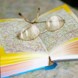 Stock Photo: Spectacles on page geographical atlas