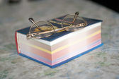 Spectacles and sheets book — Stock Photo