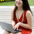 Girl working on laptop outdoor — Stock Photo