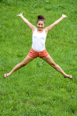 Girl doing exercises in park — Stockfoto