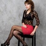 Cute gothic girl sitting on chair studio shot — Stock Photo #6263410