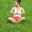 Girl meditating in park — Stock Photo