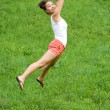Girl doing exercises in park - Stockfoto
