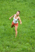 Girl doing exercises in park — Stock Photo