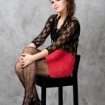 Cute gothic girl sitting on chair studio shot — Stock Photo #6358350
