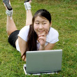 Girl working on laptop outdoor — Stock Photo #6361046