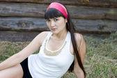 Beautiful girl sitting on hay — Fotografia Stock