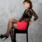 Cute gothic girl sitting on chair studio shot — Stock Photo #6480642