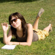 Girl lying on grass in park — Stock Photo