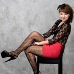 Cute gothic girl sitting on chair studio shot — Stock Photo #6487147