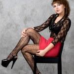 Cute gothic girl sitting on chair studio shot — Stock Photo #6554199