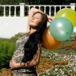 Joyful pregnant girl with colorful balloons - ストック写真