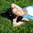 Beautiful pregnant girl lying on grass - ストック写真