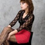 Cute gothic girl sitting on chair studio shot — Stock Photo #6574915