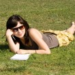 Girl lying on grass in park — Foto Stock