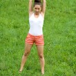 Girl doing exercises in park — Stock fotografie #6575708