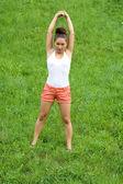 Girl doing exercises in park — Stock Photo