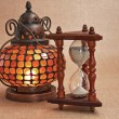 Old oriental lamp and hourglass — Stock fotografie
