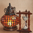 Old oriental lamp and hourglass — Stock Photo #5717734