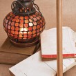 Old oriental lamps and old books — Stock Photo #5717893